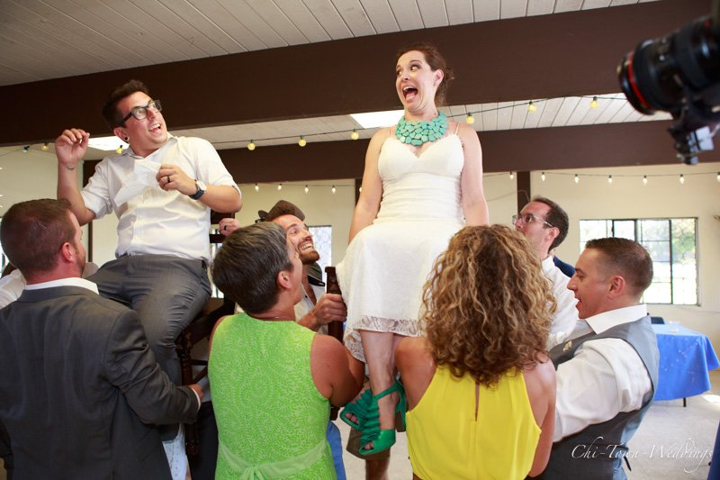 Candid Bride and Groom on the chairs during the hora