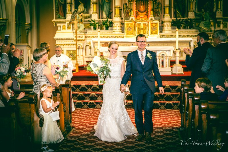 Bride and Groom candidly exiting the church
