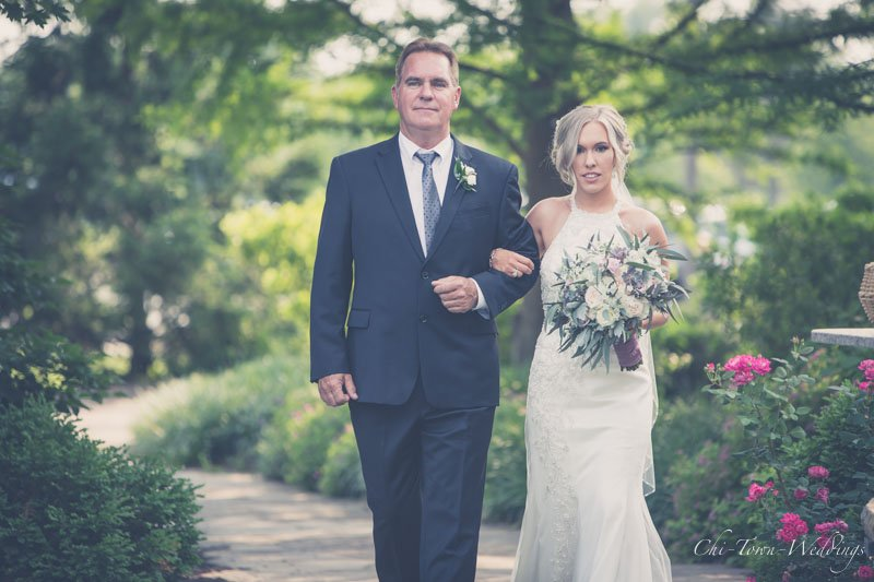 Father of Bride escorting daughter to the alter