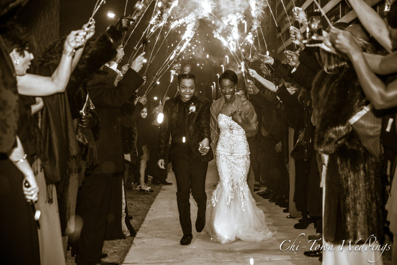 www.Chi-Town-Weddings.com  Brides walking though sparklers