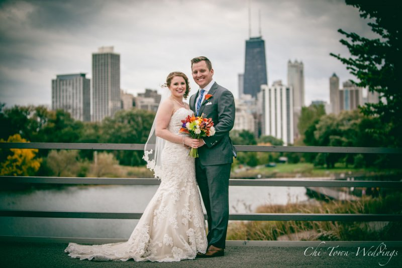 Bride and Groom in Lincoln Park on the bridge with the Chicago skyline in the background