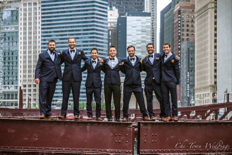 Chi-Town-Weddings-Grooms standing on Lasalle st Bridge, Chicago